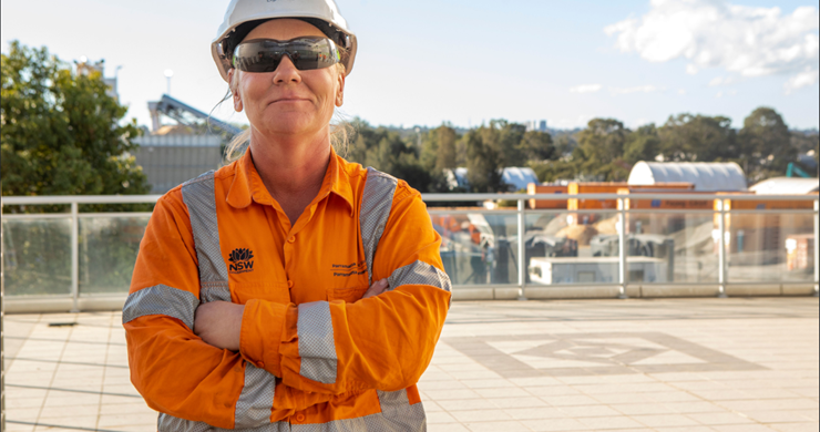 Female construction worker standing alone